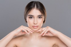 Prevention of double chin. Young beautiful woman with perfect skin massaging her face