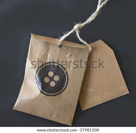 price tag and envelope for buttons with string