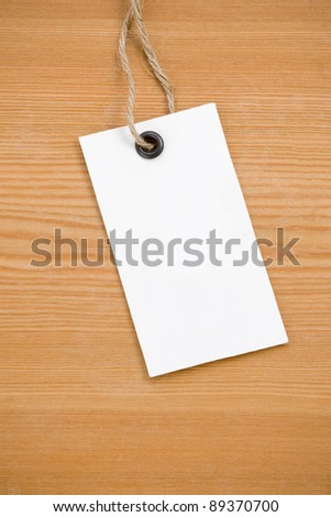 price tag on wooden board background