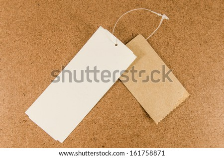Price tag or address label with string on brown background