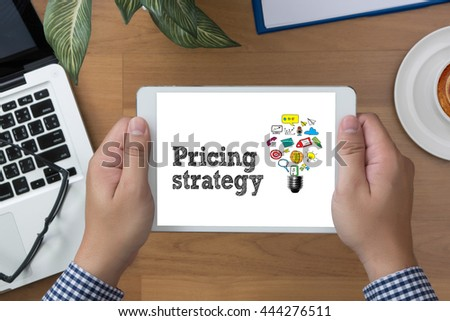 Pricing strategy  man hand Tablet and coffee cup #444276511