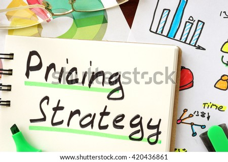 Pricing strategy sign written in a notepad. #420436861