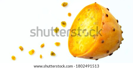 Prickly pear fruit in half across isolated on white background. Fresh sliced prickly pear and a lot of seeds with copy space. Sabra fruit. neon fruits - nopales cactus