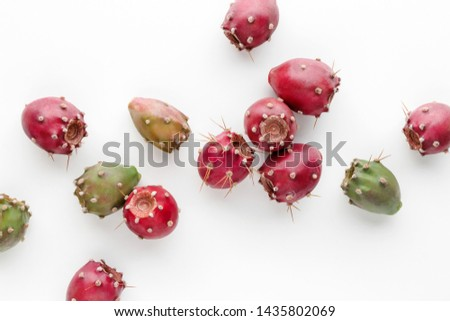 Prickly pear fruit on a white background, creative flat lay food concept, prickly pear cactus, Opuntia ficus-indica