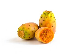 Prickly pears, healthy nopal cactus fruit, isolated on white background. One piece is cut in half, showing juicy inside.