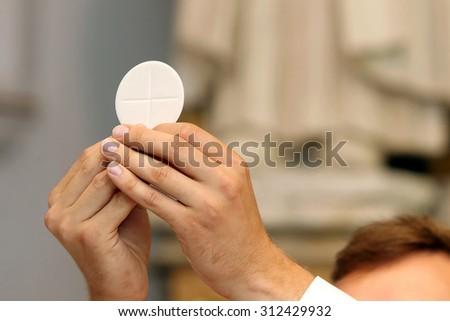 Priest celebrate a mass at the church