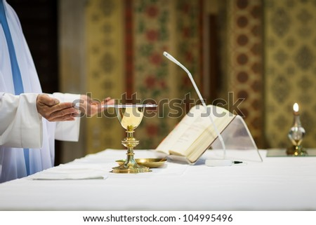 Priest during a wedding ceremony nuptial mass