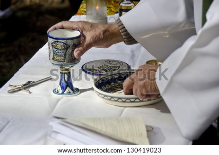 Priest hands during open air mass