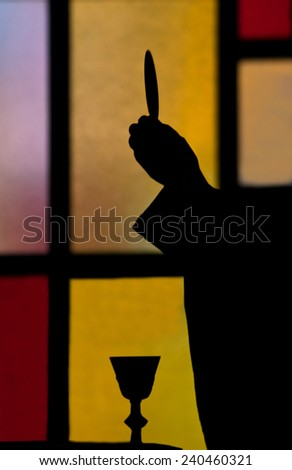 priest lifting host during the Eucharist sacrament in a Catholic church