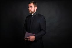 Priest on a dark background