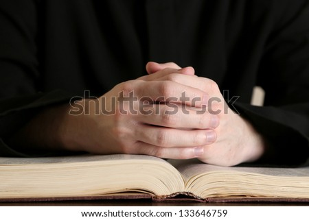 Priest reading from the holy bible, close up #133646759