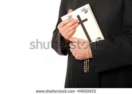 Priest's hands on bible with rosary. Real cassock.