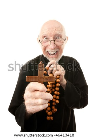Priest warding off evil with wooden cross
