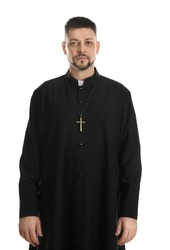 Priest wearing cassock with clerical collar on white background