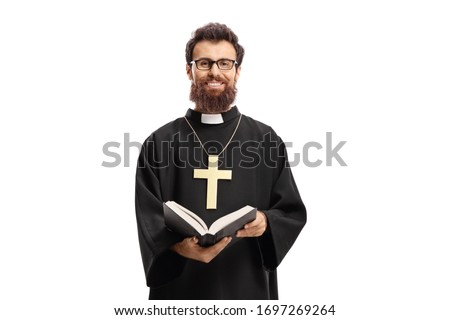 Priest with a cross and bible isolated on white background Stock fotó ©
