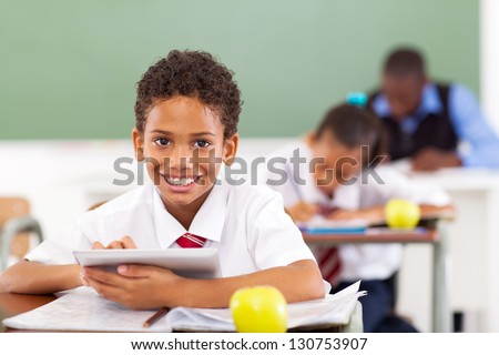 primary school boy using tablet compute in classroom