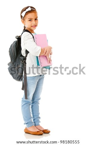 Primary school girl widh notebooks and backpack - isolated over white