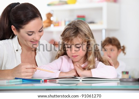 Primary school teacher with young girl