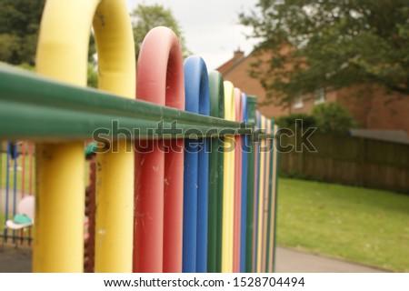 primary school yard colourful fence