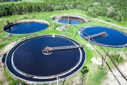 Primary sedimentation stage, sewage flowing through large circular tanks with mechanically driven scrapers