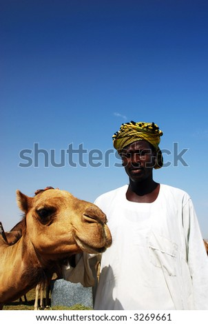 Primitive arabian man with his camel