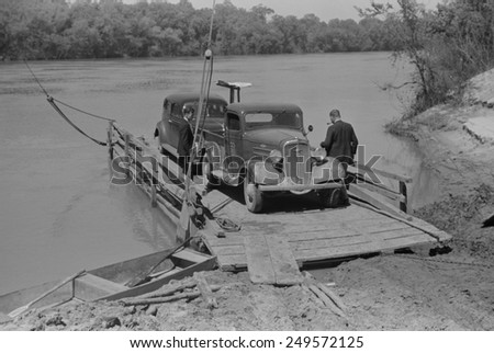 Primitive car ferry at African American community of Gee\'s Bend, Alabama, May 1939. White county government ended the ferry service to discourage voter registration in 1962.