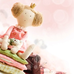 Princess doll with textile and sewing accessory - background