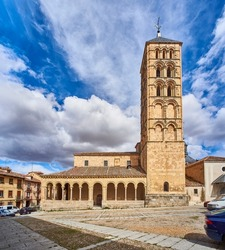 Principal facade of the church of San Esteban, a temple built in the XII century and standing out for its Romanesque bell tower. Segovia, Spain.