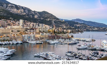 Principality of Monaco, France, on October 16, 2012. A view of the port and residential areas on a slope of mountains at sunset #257634817