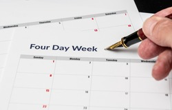 Printed calendar for a 4 day working week showing weekend days in red in new approach to productivity