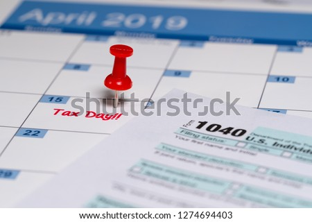 Printed copy of simplified Form 1040 for income tax return for 2018 with reminder for April 15, 2019 deadline
