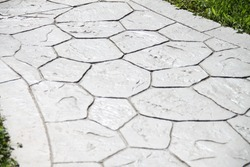Printed grey concrete path compass