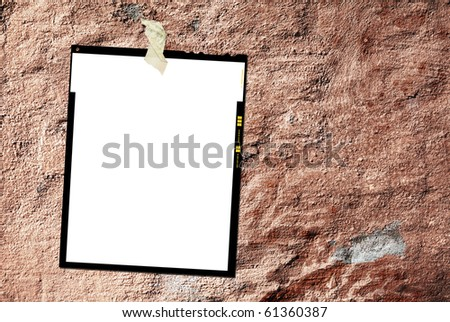 Printed large format film sheet, against grungy background, empty frame, free picture or copy space