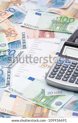 Printed student\'s budget, money and calculator. Student\'s pocket money (with rich parents).