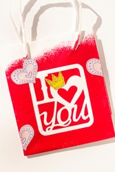 printed with stencil letters to celebrate Valentine's Day. Craft to give to your partner.