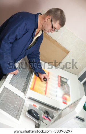 Printer at the electronic control panel of offset machine - stock photo