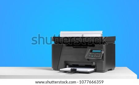 Printer copier machine on a bright colored background #1077666359