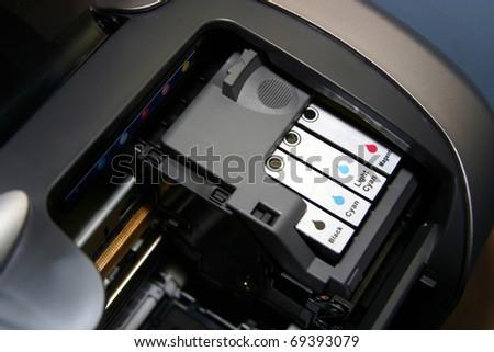 Printer ink cartridges in situ.