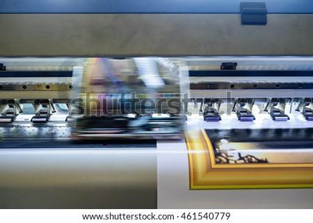Printer machine inkjet during production on vinyl banner #461540779