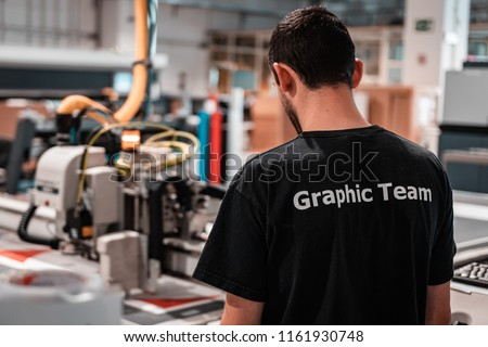 Printing facility. Working class heroes providing customers top quality editorial and commercial products. Worldwide shipping.  #1161930748