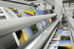 Printing machine fast roll movement during magazine print