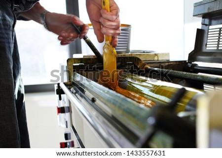 Printing. The printing process. The printer applies ink inks.  #1433557631