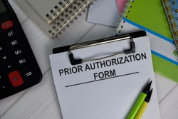 Prior Authorization Form write on paperwork isolated on office desk.