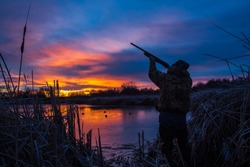 Prior to a Christmas duck hunt; I went out to a pond in Pendleton, Oregon during the blue hour (about 25 minutes before sunrise) and set up this self portrait of myself.  Title: Christmas Duck Hunt