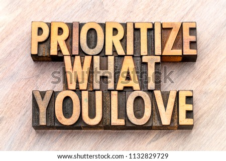 prioritize what you love - word abstract in vintage letterpress wood type