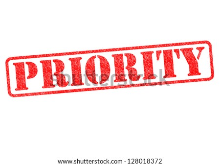 PRIORITY red rubber stamp over a white background.