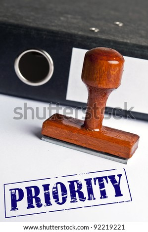 Priority stamp on white paper