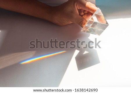 prism dispersing sunlight splitting into a spectrum