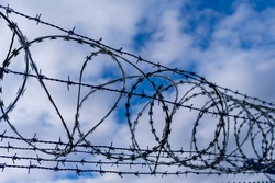 Prison barbed wire. Prison fence. Strict punishment for crimes