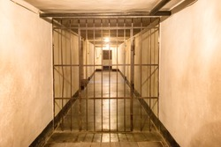 Prison cell with jail iron bars for criminals